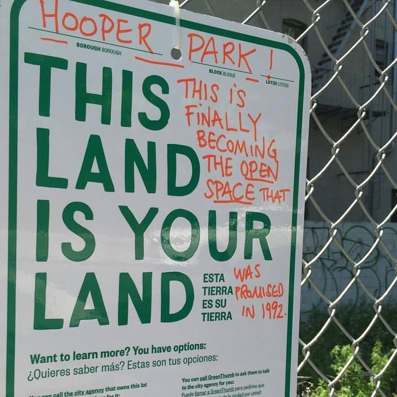 596 Acres sign on fence at Hooper Park in southside Williamsburg