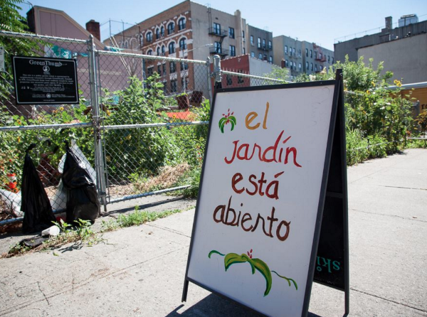 "A sign outside Keap Fourth Community Garden on Williamsburg's Southside reads ""El Jardin Esta Abierto"""