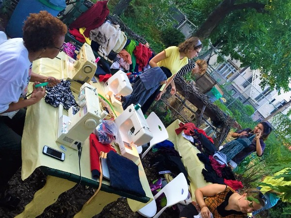 People using sewing machines in 1100 Bergen Street Community Garden
