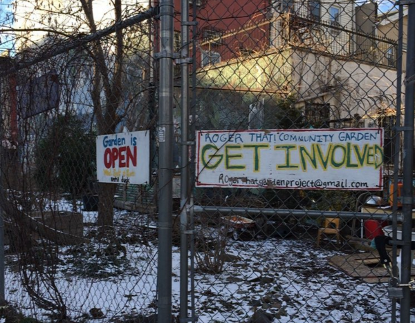 Signs on Roger That! community garden fence